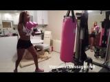 Ebony Female boxer working on the bag