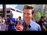 Chris Colfer talks with The Hollywood Reporter about the Land of Stories on the red carpet at the Teen Choice Awards, July 22, 2