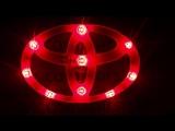 Эмблема с двухцветной светодиодной подсветкой Toyota красного и белого цвета