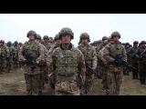Soldiers from the United States, United Kingdom, Romania and Poland. Battle Group Poland