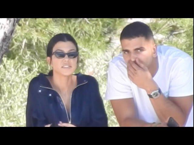 EXCLUSIVE: Kourtney Kardashian and her new beau Boxer, Younes Bendjima, enjoy the view over the cap