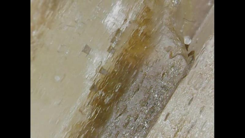 поверхня кристалу скаполіту (599)