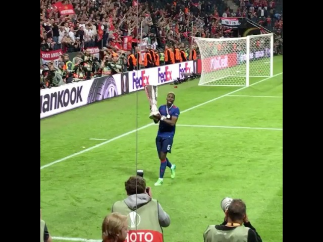 Pogba celebrates winning the Europa League with Man United fans