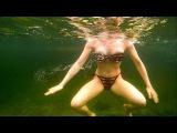 Girl swimming underwater in Full Face FreeBreath EasyBreath snorkel mask + fish-scale bikini + gopro