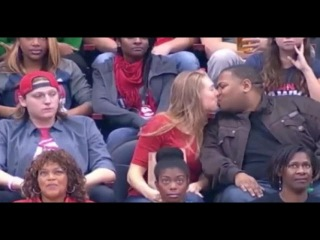 Snubbed girlfriend snogs the man next to her after her boyfriend rejects her on kiss cam