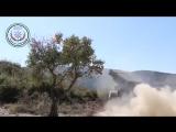 Боевиков Первой Прибрежной Дивизии ССА ведет огонь по позициям сирийской армии припомощи РСЗО БМ-21 Град на северо-востоке прови