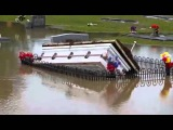Graveyard Flood Caskets Erupt To Surface