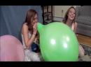 College girls blow to pop balloons race