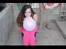 Pink Yoga Pants, Red Lip Stick Looner Brunette Girl Sit Pop Blow Popping Inflatable Balloons