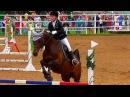 Конкур. Преодоление препятствий на лошади. Юная наездница.