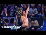 AJ Styles raises his hands high as the new WWE World Champion Backlash 2016