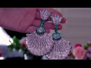 De Grisogono earrings from new Haute Joaillerie collection with diamonds, emeralds, in titanium.