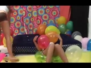 College girls pop balloons