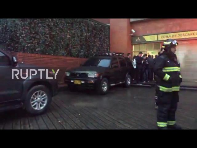 Колумбия: Аварийные службы на месте после взрыва в торговом центре Боготы.