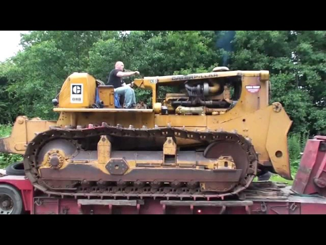 Caterpillar D9G donkey start and unloading off a low loader