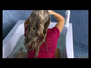 Wetlook Blonde Fully clothed in pool