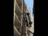 Austin - Driver escapes from hanging car after driving off parking garage