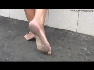 Barefoot sexy Blonde girl whit dirty feet in street