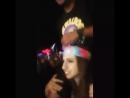 Girl lift carry her male friend on shoulders during concerts casually