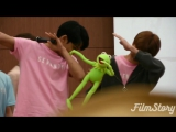 these are Twenty Year Old Men dabbing with a kermit toy