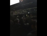 Arseanal fans shouting on the team bus