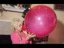 Girl blow to pop big red balloon