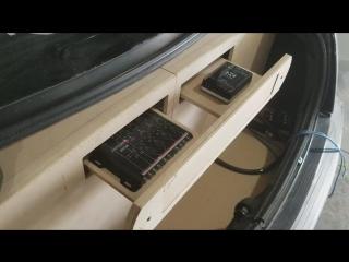 Моторизованная панель в багажнике