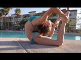 A Very Flexible Gymnastic Girl Training Near the Pool