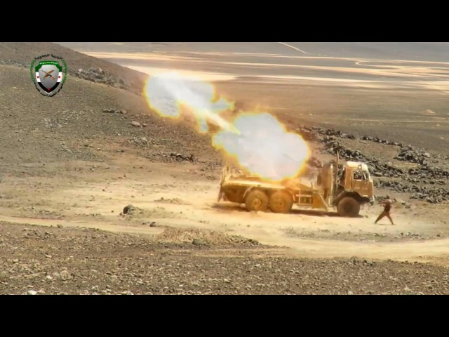 FSA hit regime foreign militia positions in Syrian Desert with rocket launchers heavy artillery