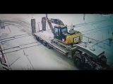 Freight Train Hits Truck Carrying Excavator