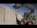 Бронированный мини погрузчик John Deere 325