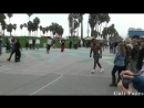 Guy Flips Over 7 People Stands On His Face - Street Performers -