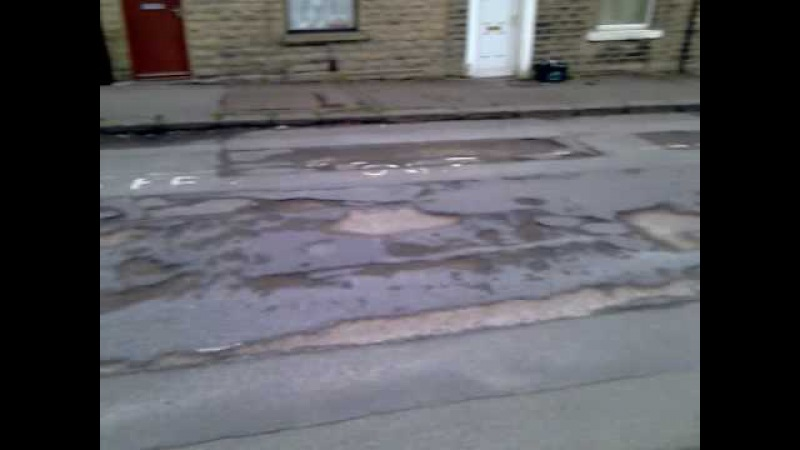 Pot holes.Yorkshire has been to visit a road in Huddersfield described as one of the worst . Smithy Lane has an estimated 124 po