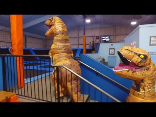 Jurassic Trampoline Park with Tooth the Inflatable T Rex - Costume Dinosaur Doing Double Backflip