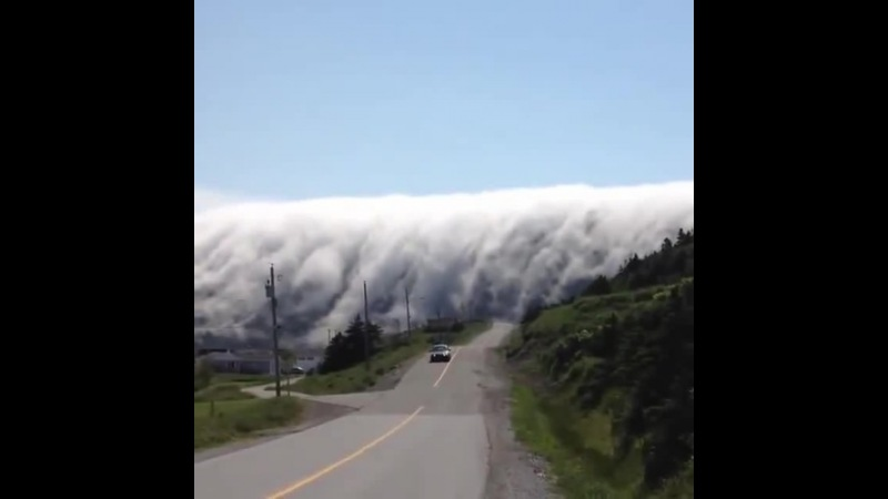 Cloud waterfall over Long Range Mountains in Lark Harbour, Newfoundland, Cana...