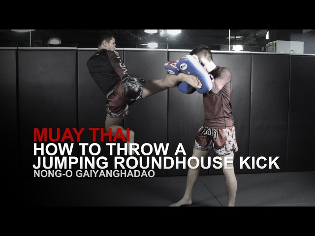 Muay Thai: How To Throw A Jumping Roundhouse Kick | Evolve University
