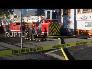 США: Пожарные ищут выживших после Окленд ночного клуба блеске.