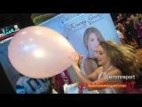 Kimmy Granger blowing up balloon