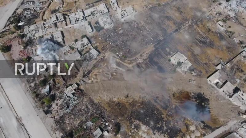 Видео с беспилотника обстрела сирийской армией позиций боевиков Хаят Тахрир Аль-Шам.