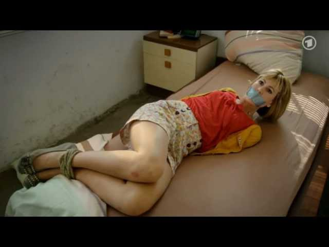 Blonde MILF undergoes forced masturbation after being tied up and ball gagged  646056