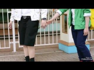 Bakugou and deku holding hands at an amusement park