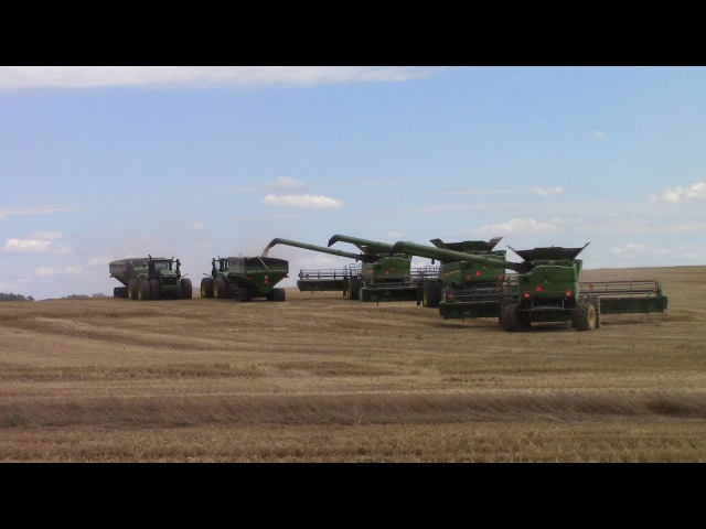 Fleet of Big John Deere Farm Machines Harvesting Wheat Seeding Soybeans