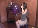 Alenna blow to pop a purple balloon