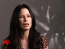 The Gates Rhona Mitra beauty and brains