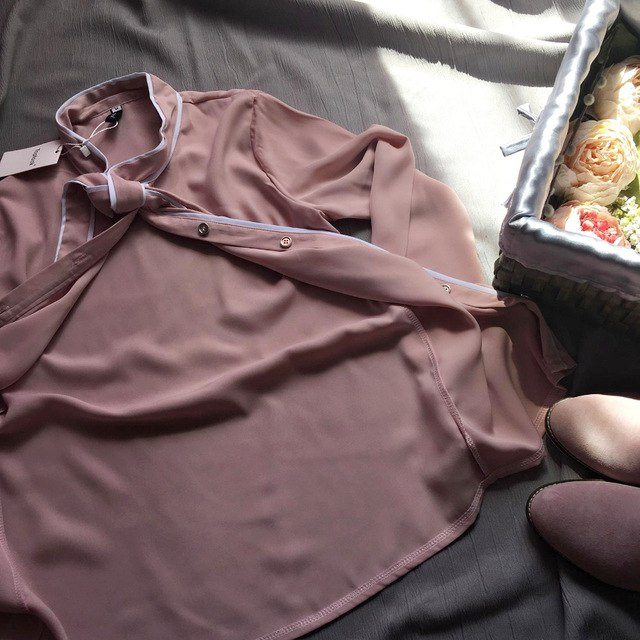 Нежно-розовая блуза из магазина Toplook