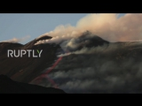 Italy Clouds of smoke billow out of Mt Etna as volcano continues to erupt