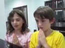 Cute children singing Buddhist prayer Namo Tassa Bhagavato Arahato Samma Sambuddhassa