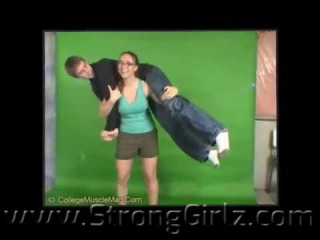 claire lifting and carrying her brother