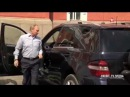 Russian leader opens car door for mysterious lady in red.