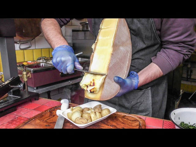Yummy Swiss Raclette Warm Melted Swiss Cheese with Egg and Potatoes London Street Food